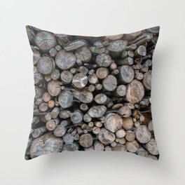 Pile of cut logs for firewood. Wooden texture. Throw Pillow