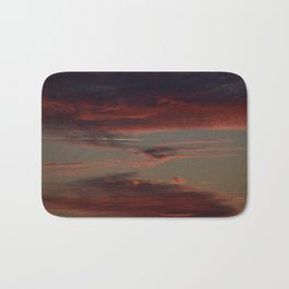 Airplane Soaring Through Sunset-Lit Clouds Bath Mat