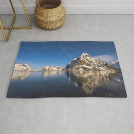 Swirling Stars Above Arctic Mountain Landscape Rug