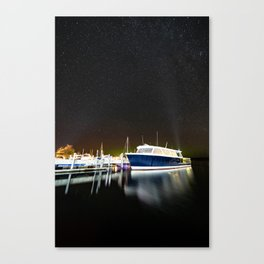 Boats under the milky way Canvas Print
