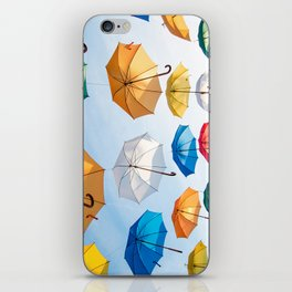 umbrellas flying iPhone Skin