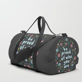 BE PROUD OF WHO YOU ARE - Motivational quotes hand drawn illustration with flowers on dark backgroun Duffle Bag