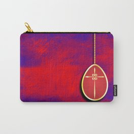 Gold cross in red egg hanging against a rich red and purple Carry-All Pouch