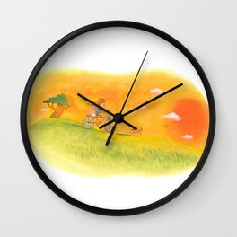 Children playing in the field at the sunset Wall Clock