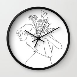 she carries love in her soul Wall Clock