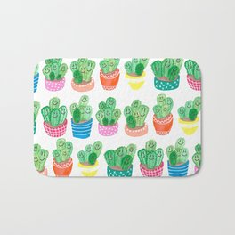 Cacti in fancy pots with smily faces. Bath Mat
