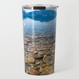 Snow-capped mountains view in summer from the rocky shore of lake Wakatipu. Travel Mug