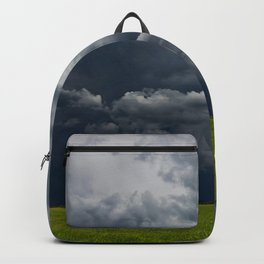 Supercell storm clouds above meadow with green grass Summer Storm clouds Backpack