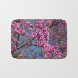 Blue skies and redbud in spring Bath Mat