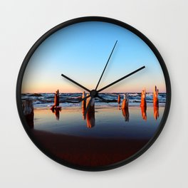 Reflected Remains on the Beach Wall Clock