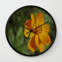 rileigh smirl Wall Clocks featuring Orange Flower by Rileigh Smirl