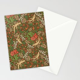 Beige lizard among pomegranate flowers and acacia false on brown background Stationery Cards