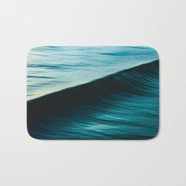 Blurred deep blue ocean swell wave California Bath Mat