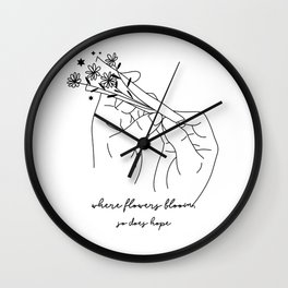 Where flowers bloom, so does hope - Minimalist Line Art Hand Holding Flowers Wall Clock