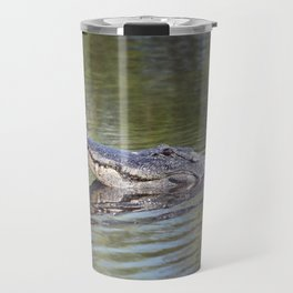 Large American alligator looking out of water in Florida lake Travel Mug