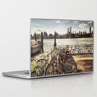 bikes Laptop & iPad Skins featuring NYC Bikes by Dnzsea