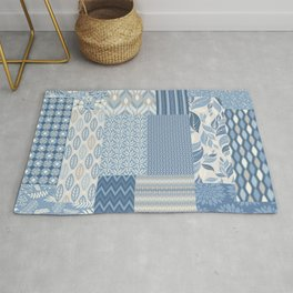 Modern Patchwork Quilt Pattern with Flowers and Geometric Shapes in Blue and Warm Gray Rug
