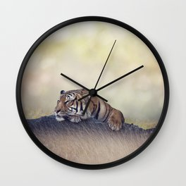 Bengal tiger resting on a rock Wall Clock