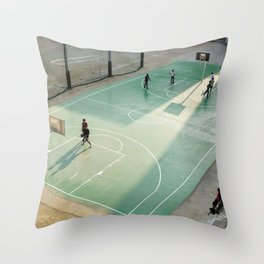 field and basketball players Throw Pillow