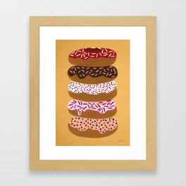 Stacked Donuts on Yellow Framed Art Print