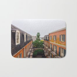 The Colorful Buildings and Palm Trees in New Orleans Bath Mat