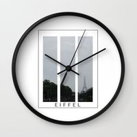 eiffel Wall Clocks featuring Eiffel by Samantha Reichert