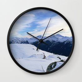 The snowy rocks at mountain tops Wall Clock