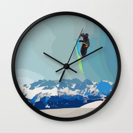 Man on skis, sky jumping, with mountains and blue sky on the backgound Wall Clock