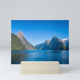 A small boat in the morning at Milford Sound Mini Art Print