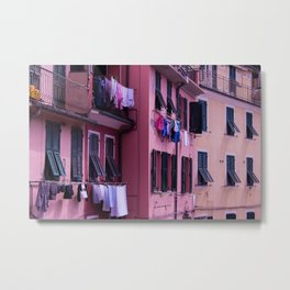 Tuscan building with its typical windows and balconies with clothes drying in the sun Metal Print