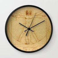 da vinci Wall Clocks featuring Leonardo da Vinci - Vitruvian Man by Elegant Chaos Gallery