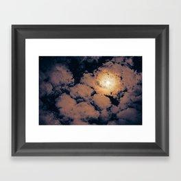 Full moon through purple clouds Framed Art Print