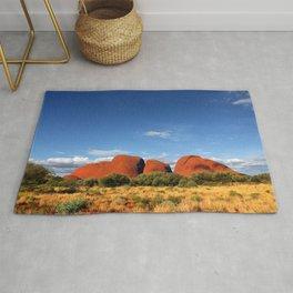 A landscape shot of Kata Tjuṯa / Mount Olga at Uluru in the outback of Australia Rug