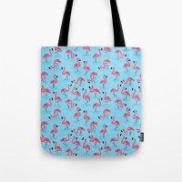 flamingos Tote Bags featuring Flamingos by WanderingBert / David Creighton-Pester