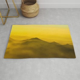 Colorful mountains in clouds - like painting, defocused, abstract yellow sunset illustration Rug