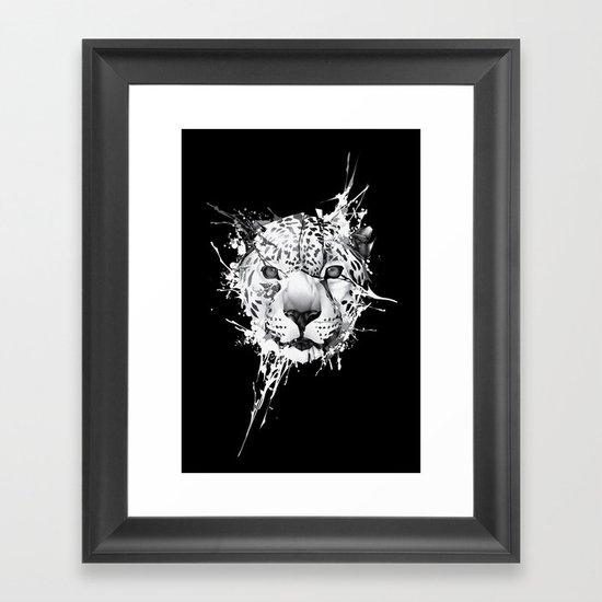 Leopard on black background Framed Art Print