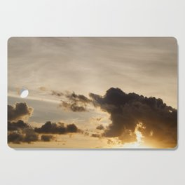 the sky during sunset Cutting Board