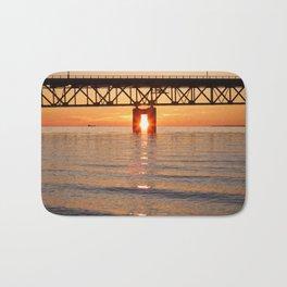 The Mackinac Bridge and the sun in between Bath Mat