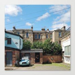 Vintage Blue Car in a Bright Glasgow Tenement Building Courtyard Canvas Print