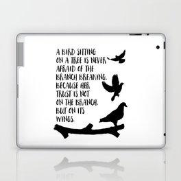 A bird sitting on a tree Laptop & iPad Skin