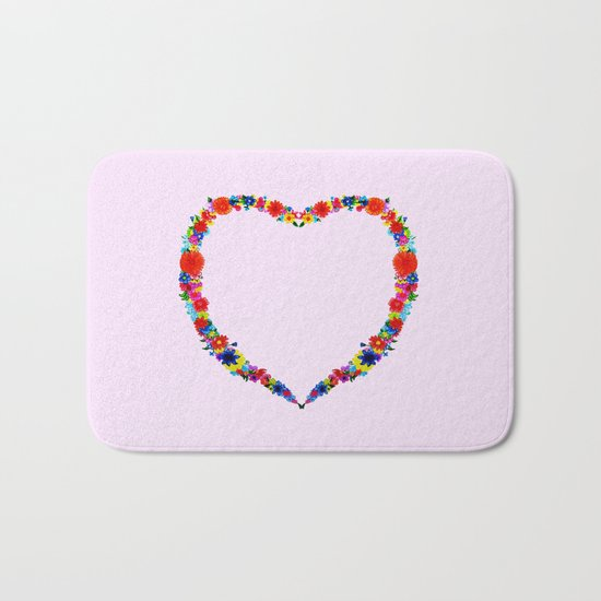 heart made of flowers on a pink background Bath Mat