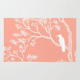 Crow in a tree peach color Rug