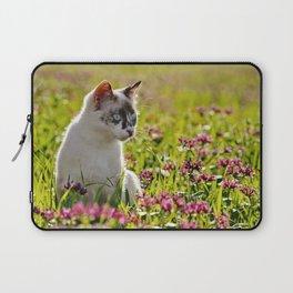 tortoiseshell cat in a meadow Laptop Sleeve
