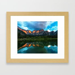 Burning sunset over the mountains at lake Fusine, Italy Framed Art Print