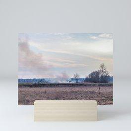 Fire on the field Mini Art Print