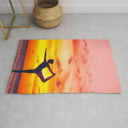 Yoga dancer's pose woman at sunset Rug