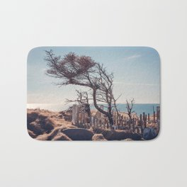 Graveyard by the sea Bath Mat