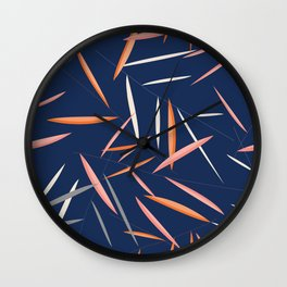 Colored leaves in a dark blue background Wall Clock