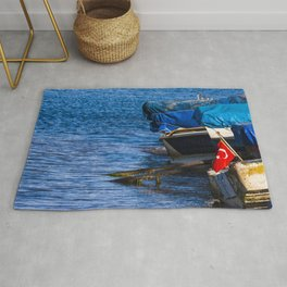 Boats at seaside in the turkish blue aegean sea Rug