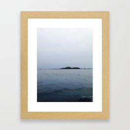 Lonely island in cloudy Brittany Framed Art Print